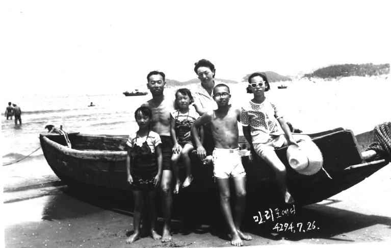 The Kim Family on their annual seaside vacation somewhere beyond Seoul, circa 1960s.