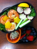 Koreanese bento #9: Butter shrimp, radish tulips, bell pepper flowers, celery stems and parsley leaves over rice; baked parmesan tomatoes and fresh berries.